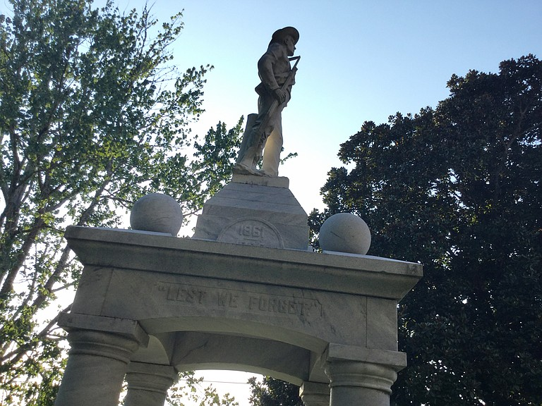 """In Ellisville, in the heart of the """"Free State of Jones,"""" the memorial is ornate and direct, """"less we forget"""" the Confederate cause. """"The principles for which they fought live eternally,"""" one side states."""