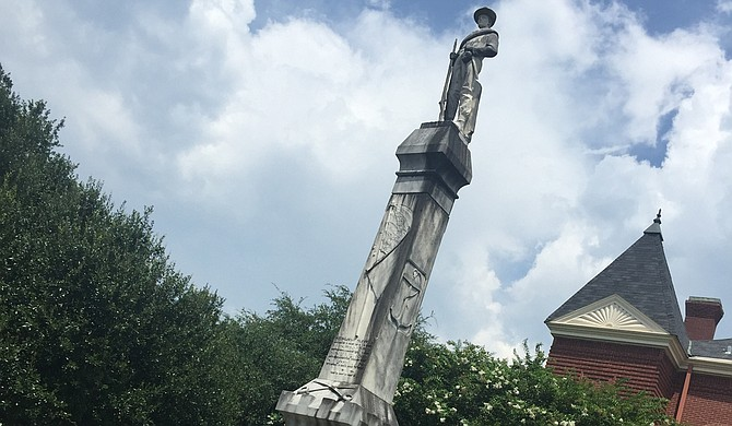 """The Confederate statue in front of the Holmes County courthouse in Lexington salutes the """"heroism,"""" """"glory"""" and """"patriotism"""" of the soldiers, alluding to the cause, but not stating it outright. Credit: Donna Ladd"""