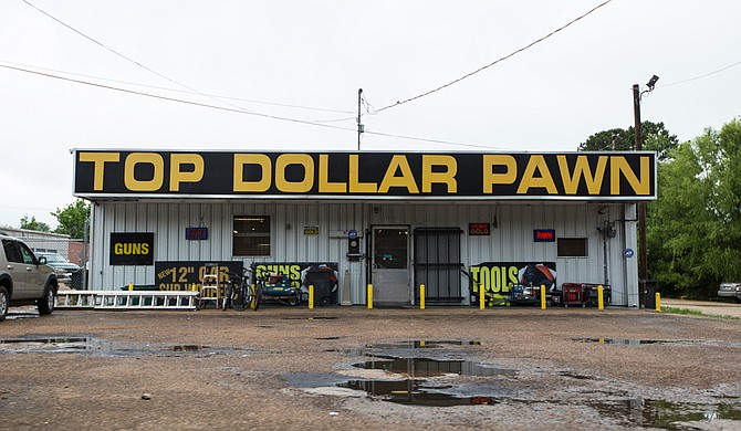 """Top Dollar Pawn Shop published on its Facebook account that it is """"permanently closed,"""" but it was still open for business at press time."""