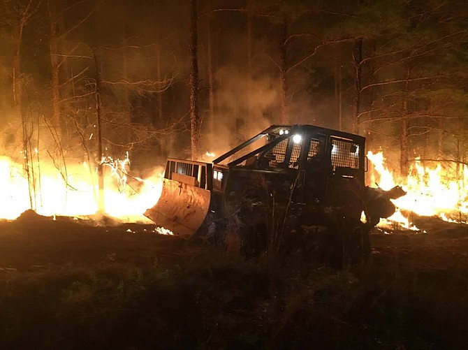 Wildfire season flared this spring; this blaze in Pearl River County in March burned 643 acres and took almost nine hours to contain. Photo courtesy Travis Rubio and MS Forestry Commission