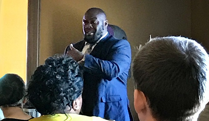 Head of Redeemer's School DeSean Dyson speaks before a crowd at Koinonia Coffee House in Jackson on June 9. Photo courtesy Rachel Fradette