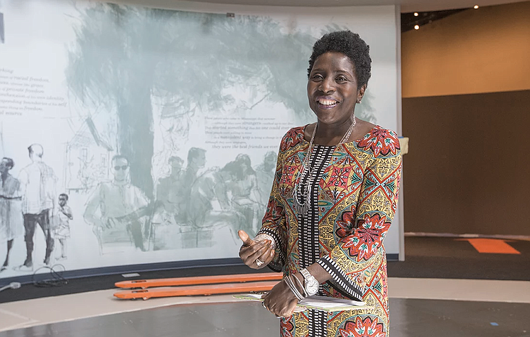 "Civil Rights Museum Director Pamela Junior stands in Gallery 3, the ""Reflections"" room of the state's new Civil Rights Museum on June 27. It and the Museum of Mississippi History opens Dec.9."