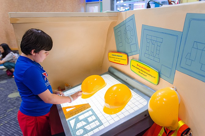 "The ""Curious George: Let's Get Curious"" exhibit at the Mississippi Children's Museum focuses on areas such as science, technology, engineering, art and math, collectively known as STEAM. Photo courtesy Mississippi Children's Musuem"