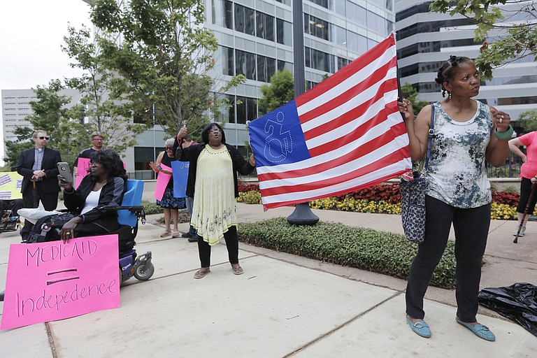 """Protesters gathered in front of Sen. Thad Cochran's Jackson office, calling on the senator to vote """"no"""" on the Senate health-care bill, which the Congressional Budget Office said would leave 22 million Americans uninsured by 2026."""