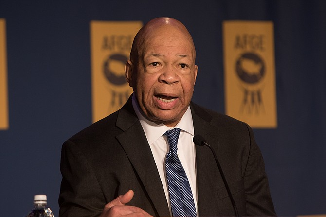 Rep. Elijah Cummings, D-Md. (right), said in a letter to businessman Bijan Kian that he also wants Kian to produce documents relating to Michael Flynn's travels and ties to foreign businesses. Photo courtesy Flickr/American Federation of Government Employees