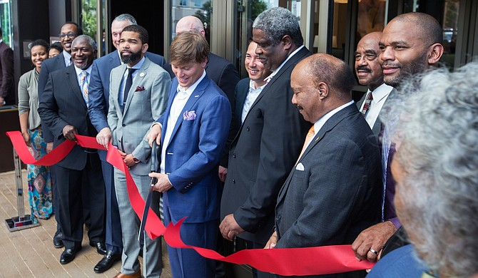 City, county and state leaders helped Joseph Simpson (center) cut the ribbon outside the new Westin Hotel in downtown Jackson on South Congress Street.