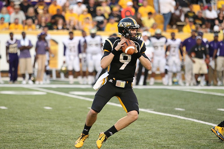 Southern Miss will have to maintain its momentum with a new quarterback. Four-year starter Nick Mullens (pictured) is now gone and there's a preseason battle under center between sophomore Keon Howard and junior Kwadra Griggs. Photo courtesy USM Athletics