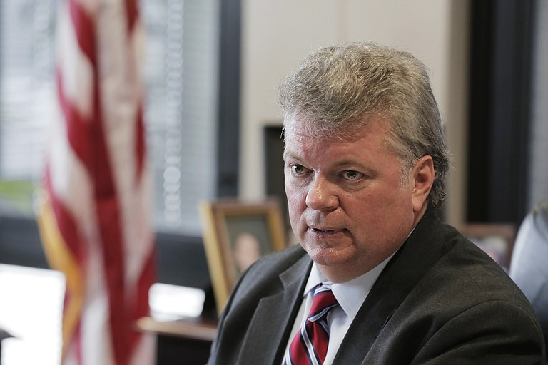 Attorney General Jim Hood settled claims with Global Tel*Link Corp. for $2.5 million, which is the second of 11 civil actions Hood filed as a result of the Christopher Epps scandal.