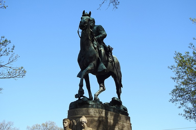 """The mayor of Charlottesville on Friday called for an emergency meeting of state lawmakers to confirm the city's right to remove a statue of Confederate Gen. Robert E. Lee, saying recent clashes over race and the Confederacy had turned """"equestrian statues into lightning rods."""" Photo courtesy Flickr/xiquinhosilva"""