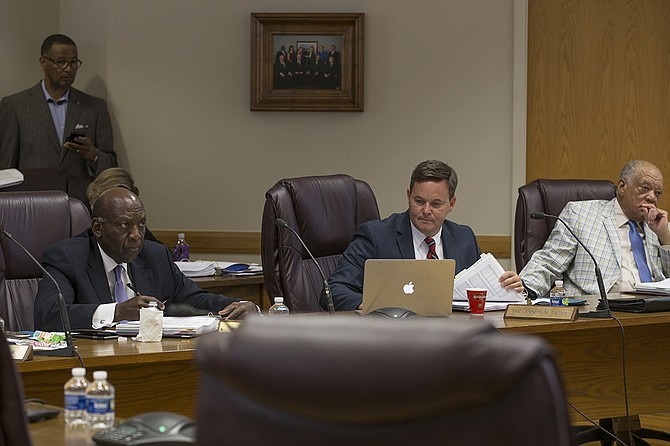 Mississippi Board of Education members John Kelly, Jason Dean and Charles McClelland (left to right) all had questions about changing the baseline for state test scores at the board's meeting on Thursday, Aug. 17.