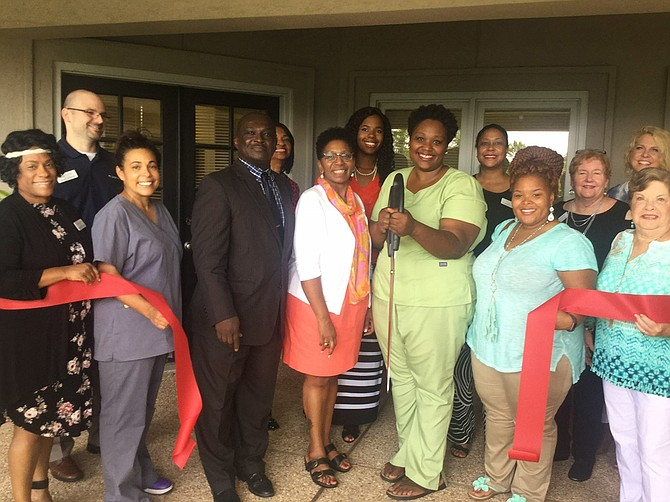 Tiffany Hathorn (center right), owner of Nail Envy Salon in the Regions Plaza building downtown, held a grand opening for her new business, Envy Life Nutrition Club on Aug. 17. Photo courtesy Tiffany Hathorn