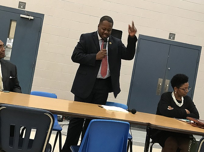 Ward 6 Councilman Aaron Banks hosted a townhall meeting about crime Thursday night at Forest Hill High School. In addition to the usual line-up of police officers at the front table, Banks focused on the need for residents, especially men, to praise and guide young people on their block.