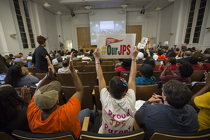 "Parents and advocates who oppose the state takeover of Jackson Public Schools watched the State Board of Education meeting from the second-floor auditorium on Thursday; JPS supporters cheered when Interim Superintendent Freddrick Murray asked the board to not declare an ""emergency."""