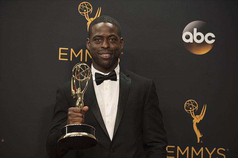 "Sterling K. Brown, whose role in ""This Is Us"" earned him the top drama series actor trophy, paid tribute to the last African-American man to win in the category, Andre Braugher in 1998 for his role as a police detective in ""Homicide: Life on the Street."" Photo courtesy Flickr/Disney/ABC Television Group"