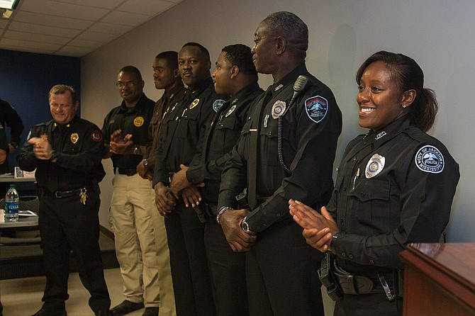 Officer Cossandra Felton (right) is Jackson's first woman SWAT officer. Also pictured, from left: JPD SWAT Commander Steve McDonald, Hinds County Deputy Keith Barnett Sr., Deputy Keith Barnett Jr., JPD Corporal William Wade, and JPD Officers Cornnel Norman and George Moore Jr. Photo by Stephen Wilson