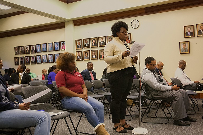 Janelle Jefferson, the PTA president at Davis IB Elementary School, read the school's resolution to the Jackson School Board of Trustees announcing the school's name change to Barack Obama Magnet IB Elementary School. Photo by Stephen Wilson