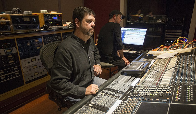 (Left to right) Malaco Music Group President Tommy Couch Jr. and Kent Bruce, chief engineer and head of production, behind the board at Malaco Studios in west Jackson.