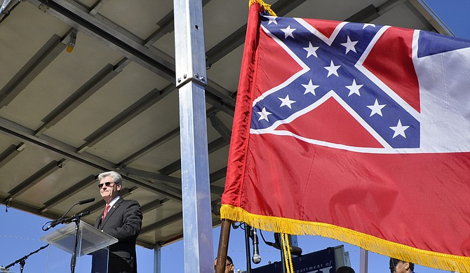 Gov. Phil Bryant told the U.S. Supreme Court that Carlos Moore cannot show that the state flag discriminates in the same way that bans on same-six marriage did before declared unconstitutional. Trip Burns/File Photo