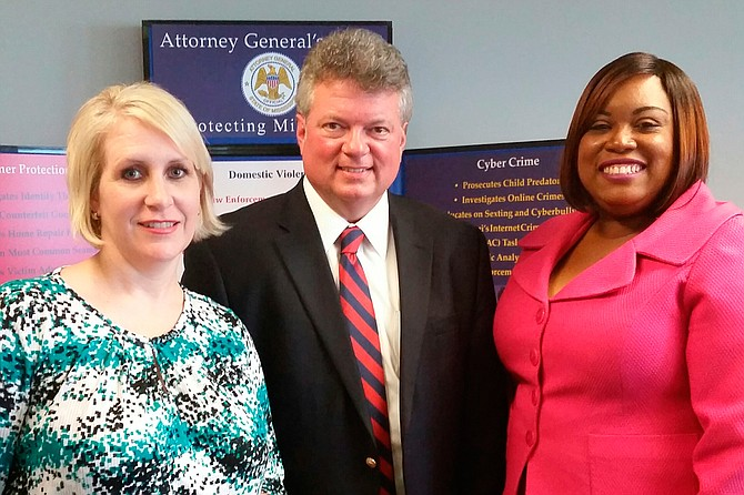 Cathy Green (left) was honored during Victims' Rights Week in 2015 with the Image of Resilience Award, pictured here with Attorney General Jim Hood (middle) and Wendy Mahoney of the Mississippi Coalition Against Domestic Violence (right). Photo courtesy Mississippi Coalition Against Domestic Violence