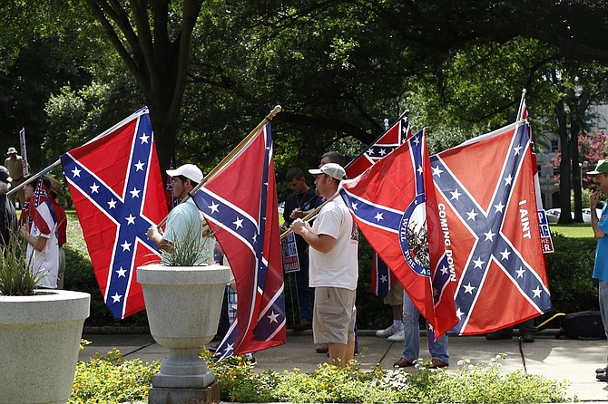 Mississippi has used the same flag since 1894 and it has the last state banner featuring the Confederate symbol—red field topped by a blue tilted cross dotted by 13 white stars. Critics say the symbol is racist. Supporters say it represents history.