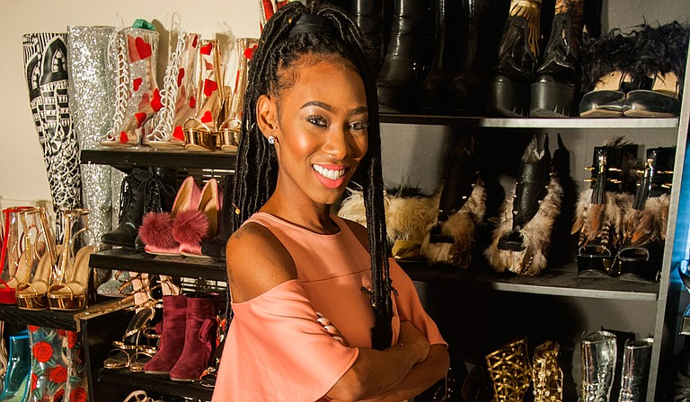 Meeya Thomas created her first shoe line in 2013 and has been doing it ever since. She says she owns about 200 pairs of shoes. Photo by Stephen Wilson