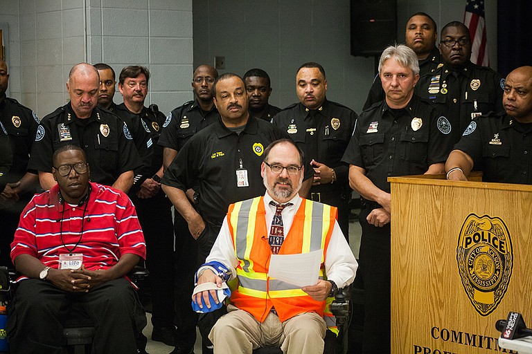 As a member of Jackson's ADA Advisory Council and Mississippi Showing Up for Racial Justice (SURJ), Scott Crawford organized for donations of 80 reflective vests to the JPD. He is pictured here at a press conference on Nov. 6. Photo by Stephen Wilson