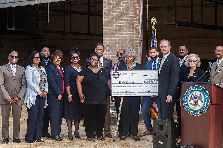 Secretary of State Delbert Hosemann's office presented Hinds County, City of Jackson and state public officials a check for tax sales on local property on Nov. 13. Photo by Stephen Wilson