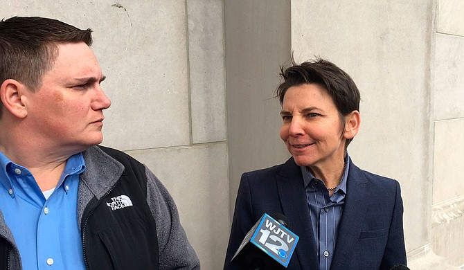 Christina Strickland (left) and her attorney Elizabeth Littrell (right) spoke with reporters outside the Mississippi Supreme Court after oral arguments in ther same-same marriage parental-rights case on Wednesday, Nov. 29.