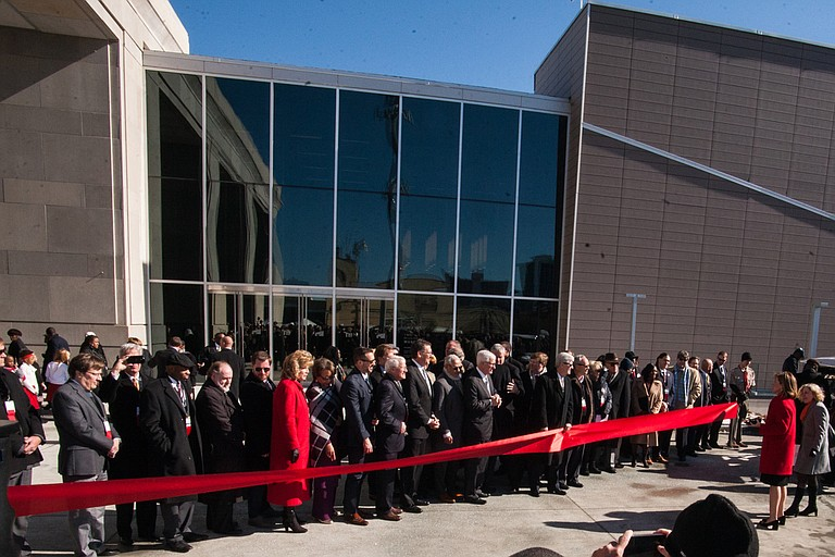 Myrlie Evers cut the red ribbon outside the Museum of Mississippi History and the Mississippi Civil Rights Museum that opened on Saturday. She also sat through remarks from President Trump at a private ceremony before the public opening.