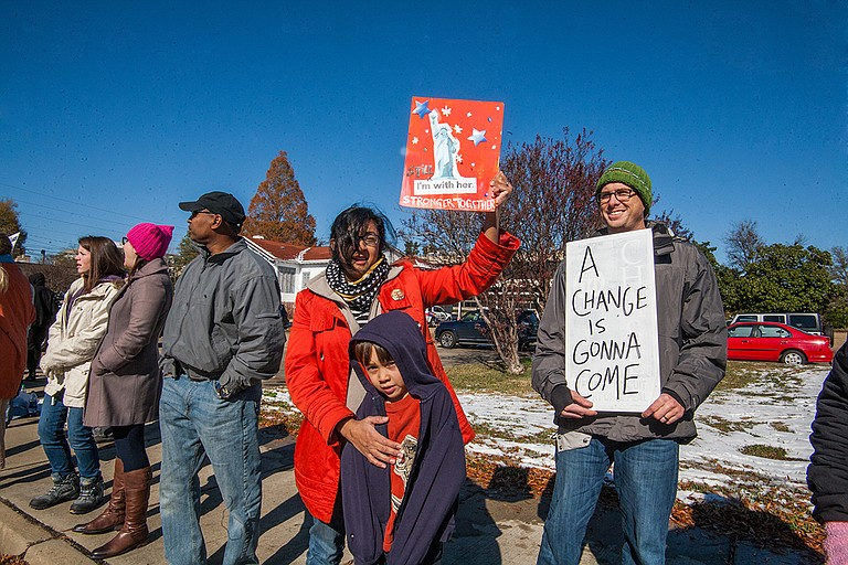 Joy Parikh (left) and Wes Harp (right) protest during the opening of the Mississippi Civil Rights Museum and Museum of Mississippi History on Saturday, Dec. 8.