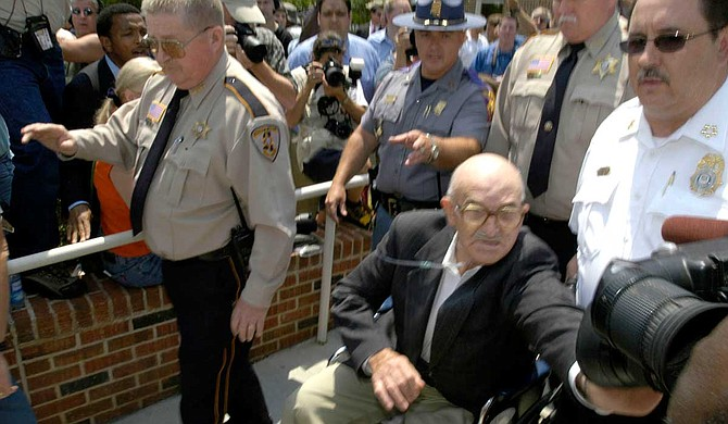 Outside his June 2005 trial in Philadelphia, Miss., former Ku Klux Klansman Edgar Ray Killen was not pleased with the hordes of media attention, even pushing a TV reporter from Jackson. Photo by Kate Medley