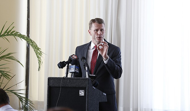"""Flanked by police and civil leaders of Jackson, Miss., U.S. Attorney Mike Hurst spent a press conference arguing for draconian acts of """"justice"""" to be inflicted on Jackson's people—primarily her poor, disenfranchised and minority residents."""