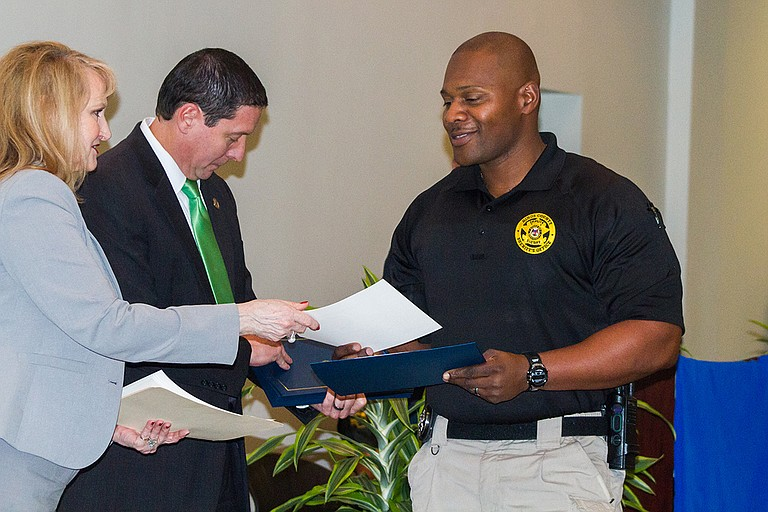 Joshua Adams, with the Hinds County Sheriff's Department, receives his Crisis Intervention Team certificate after graduating from the CIT program on Jan. 26.
