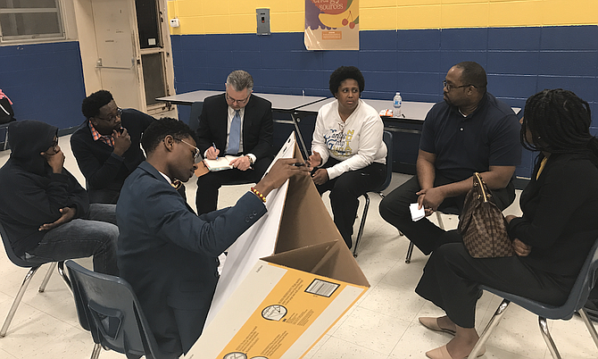 Young people in Jackson, through the Mississippi Youth Media Project and the Kappa League, are convening a series of dialogues about youth crime. Here, Jim Hill High School student Ruben Banks leads a break-out discussion about building respect between law enforcement and young people at Wingfield High School. Mississippi FBI Special Agent in Charge Christopher Freeze (in coat and tie) was his co-moderator. The next youth-crime dialogue is Thursday, March 22, from 6 to 8 p.m. at Jim Hill High School. The public is welcome.
