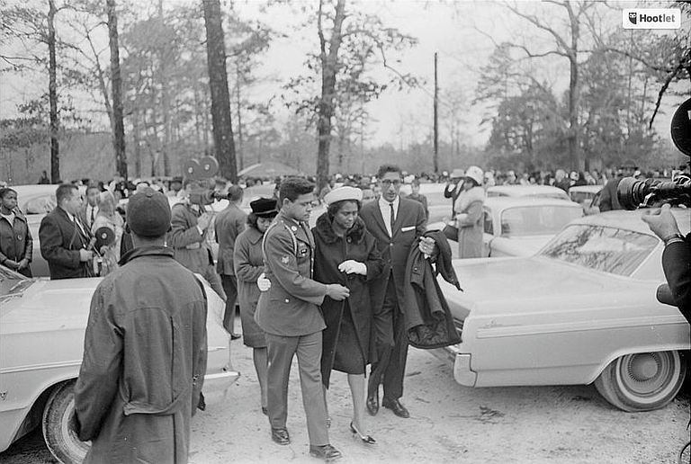Ellie Dahmer, widow of slain civil rights leader Vernon Dahmer, being assisted to her car by family members after Dahmer's funeral on Jan. 15, 1966. Photo courtesy Wikicommons/Mississippi Department of Archives and History