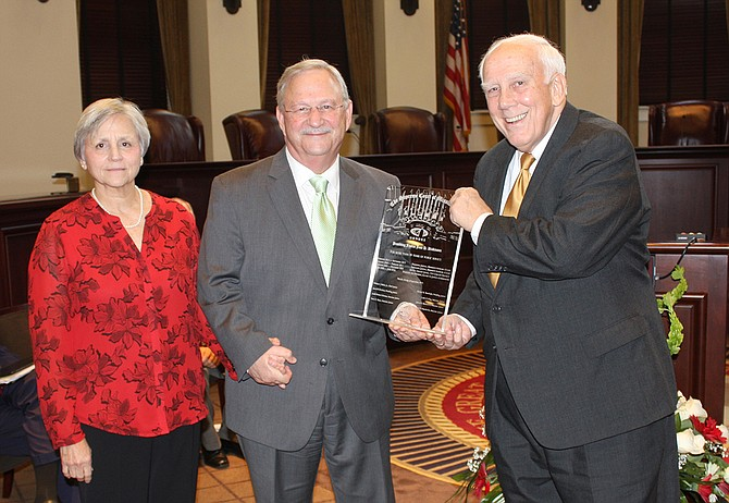 Former Mississippi Supreme Court Justice Jess Dickinson (center), pictured here with his wife Janet (left) and Justice Jim Kitchens (right), became the commissioner of the Mississippi Department of Child Protection Services in September 2017.