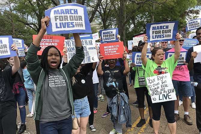 Nearly 200 people took to the streets of downtown Jackson on Saturday, March 24, 2018, for the March for Our Lives, which calls for school safety and stricter gun laws. Photo by Ko Bragg