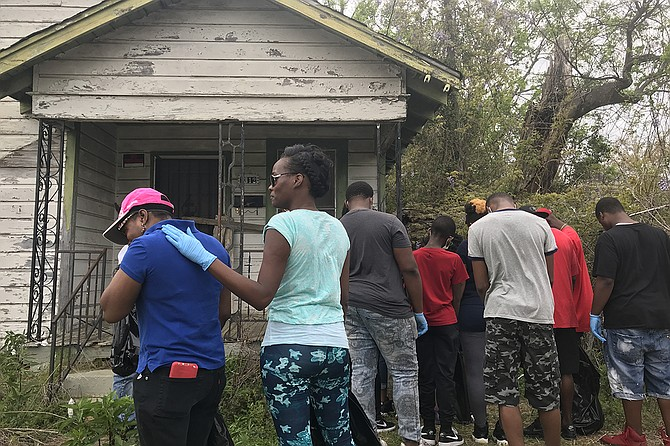 The family and friends of Lee Edward Bonner who died after JPD officers shot him on Feb. 21 gathered at the home where it took place to do a neighborhood cleanup on March 24, 2018, much like the ones Bonner organized when he was alive. Photo by Ko Bragg
