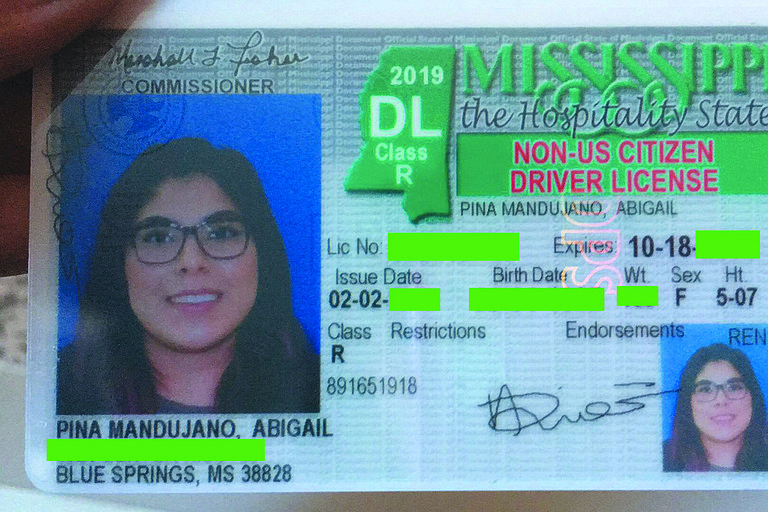"Mississippi has a policy that brands immigrants' driver licenses with the words ""Non-US Citizen"" despite the fact that they must present proof that they are in the U.S. legally to get the I.D. Photo courtesy Abigail Pena Mandujano"