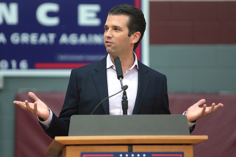 The DNC accuses Donald Trump Jr. of secretly communicating with WikiLeaks, and blames the president, too, saying he praised the illegal dissemination of DNC documents throughout fall 2016, making it a central theme of his speeches and rallies.