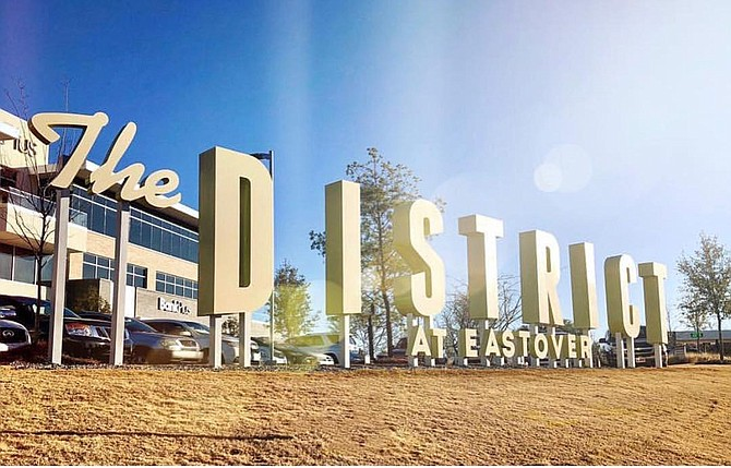 Visitors to The District at Eastover can now take alcoholic beverages, one per person, out of restaurants in plastic cups that have restaurant insignias and drink them on the District Green or on patios while the restaurants are open.
