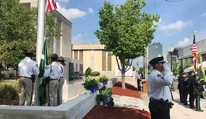 At the annual Jackson Police Department Police Memorial Service for fallen officers on May 16, 2018, City officials gave remarks before families placed yellow roses at the base of the memorial outside JPD headquarters for officers killed in the line of duty.
