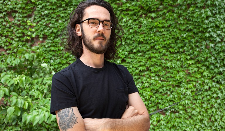 """Caleb Johnson, an Alabama-native author now living in Philadelphia, signs copies of his debut novel, """"Treeborne,"""" on Saturday, June 16, at Lemuria Books."""