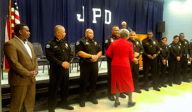 Anna Jo Bell shakes hands with Jackson police officers during the graduation ceremony for the Citizen's Police Academy on June 18.