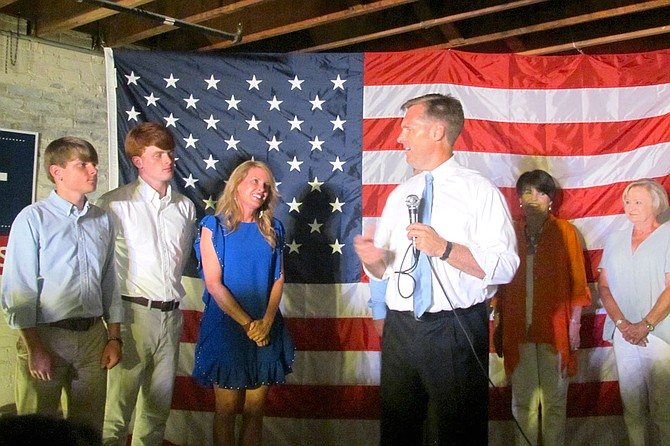 Michael Guest thanks his family for their support Tuesday evening after he won the Republican nomination for the Third U.S. Congressional District.