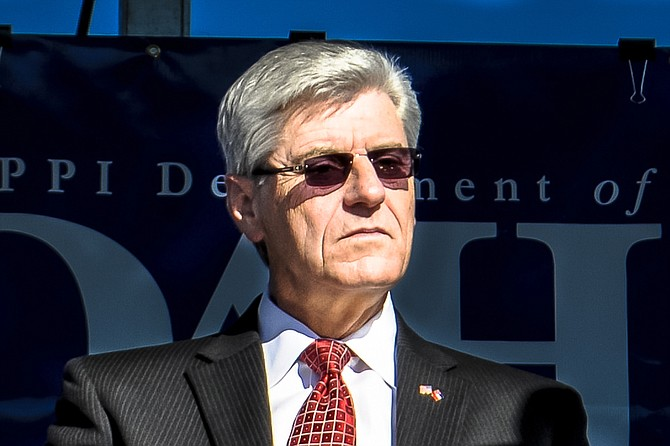 Gov. Phil Bryant says he's looking at calling Mississippi lawmakers back for a special session in August to earmark money for transportation.