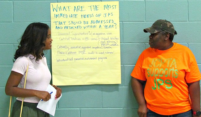 Murrah High School student Maisie Brown (left) and Michelle Henry of the Jackson Council PTA (right) talk at the People's Assembly on Jackson Public Schools' bond referendum on July 17.