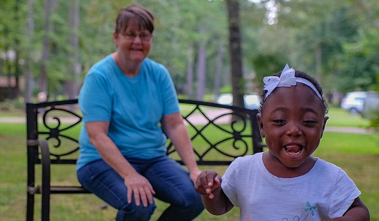 Terry Hurley, back, and her daughter Ariel Hurley, 2, play outside on July 18.