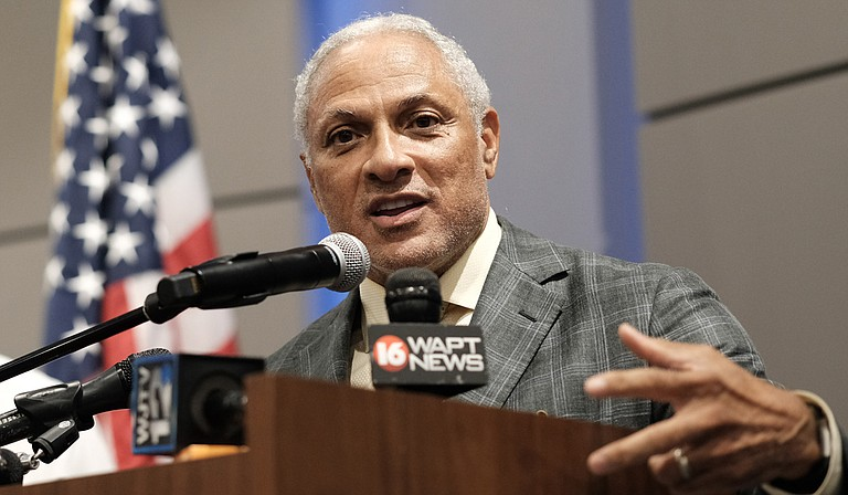 """Former U.S. Secretary of Agriculture Mike Espy says farmers are """"hurting"""" due to Donald Trump's recent tariffs. """"They want to trade. They do not want aid,"""" he says. He is pictured here at a press conference on July 20, 2014, at the Mississippi Civil Rights Museum, where he was joined by New Jersey Sen. Cory Booker."""