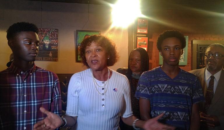 Jackson Public Schools Board President Jeanne Middleton Hairston addressed the media following the passage of the bond referendum on Aug. 7. On her left is Murrah High School sophomore Khai Thompson, and Lanier High School senior Joseph Jiles is on her right.